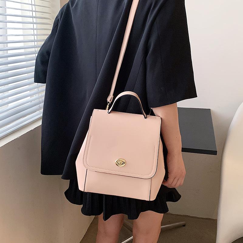 Al por mayor mochila portátil de moda con textura de bloqueo de color golpe NHTG388384