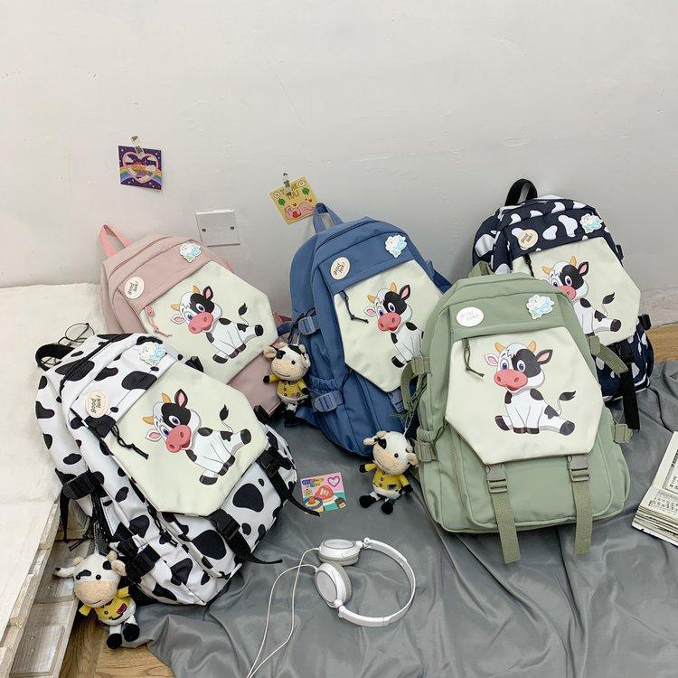 Al por mayor mochila de muñeca de vaca de dibujos animados  NHTG388413