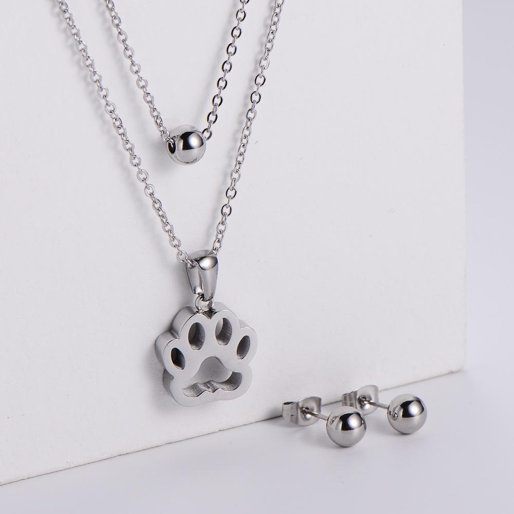colgante de huella de perro hueco collar de cadena de doble capa pendientes de tres piezas al por mayor  NHON391960