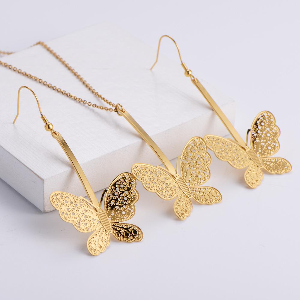 Conjunto de pendientes de collar de moda con colgante de mariposa hueca al por mayor  NHON391969