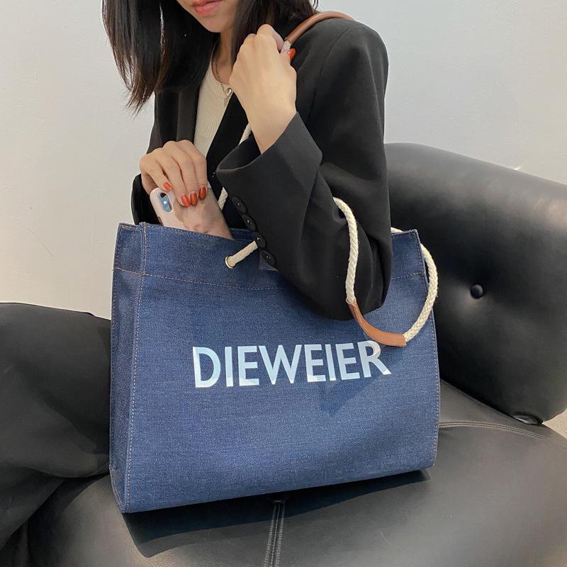 wholesale bolso de mano con estampado de letras de mezclilla de moda  NHTG392598