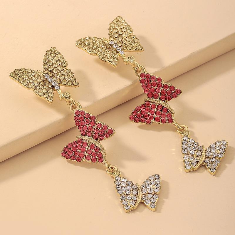 wholesale pendientes largos de mariposa de diamantes de imitación de color retro hit  NHNJ393039