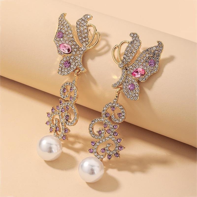 wholesale pendientes de perlas de mariposa hueca de diamantes de imitación retro  NHNJ393041