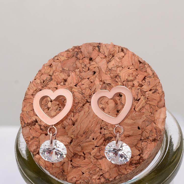Al por mayor pendientes huecos de acero de titanio en forma de corazón  NHAB393672