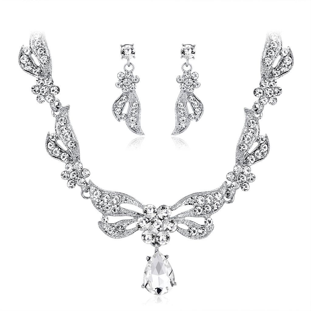 Conjunto de collar de pendientes nupciales de flores huecas blancas de moda al por mayor  NHDR405663