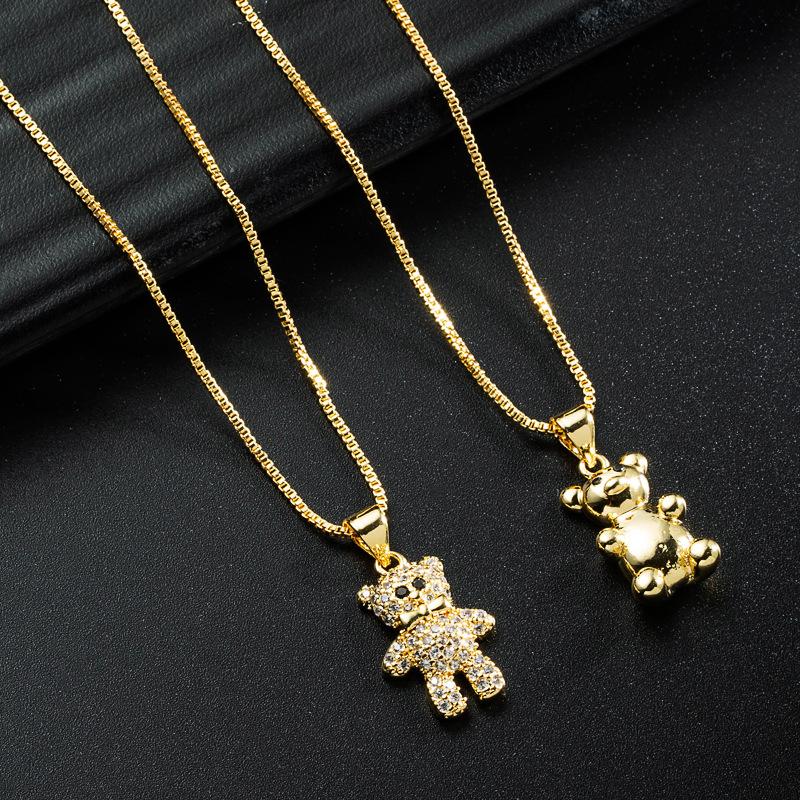 Corea simple oso dorado collar de circonitas con incrustaciones de cobre al por mayor  NHYIS395689